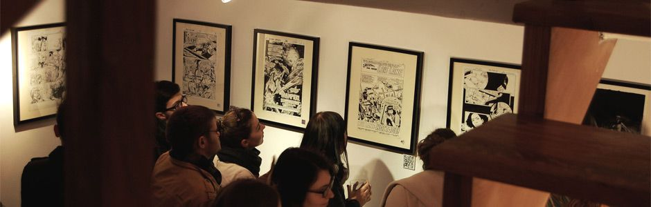 """Wystawa """"Komiks amerykański i nie tylko"""" w galerii komiksu Cheap East, Centrum Kultury Zamek, Poznań."""